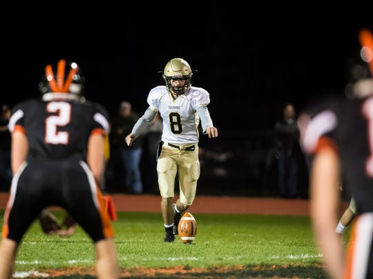 Delone Catholic's Marcello Malvone prepares to kick off to Hanover on Nov. 3, 2017. The Squires shut out the Nighthawks 54-0.