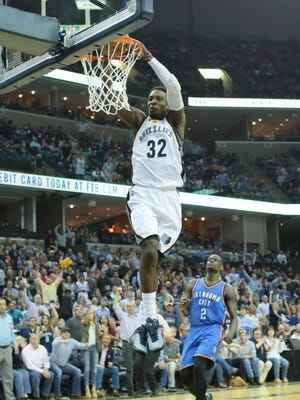 Memphis Grizzlies forward Jeff Green (32) goes up for a dunk in the second quarter as Oklahoma City Thunder guard Anthony Morrow (2) looks on at FedExForum.