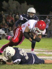 Cobre's Ben Salas rushes ahead for some yardage during