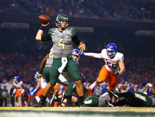 Baylor quarterback Zach Smith throws a pass in the