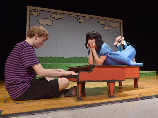 "Piano prodigy Schroeder, played by Gavin Andersson, serenades Lucy (Lizzie Fiscus) during a rehearsal for the Sevastopol School production of ""You're a Good Man, Charlie Brown."" For the show, Andersson actually is playing the mini piano on stage."