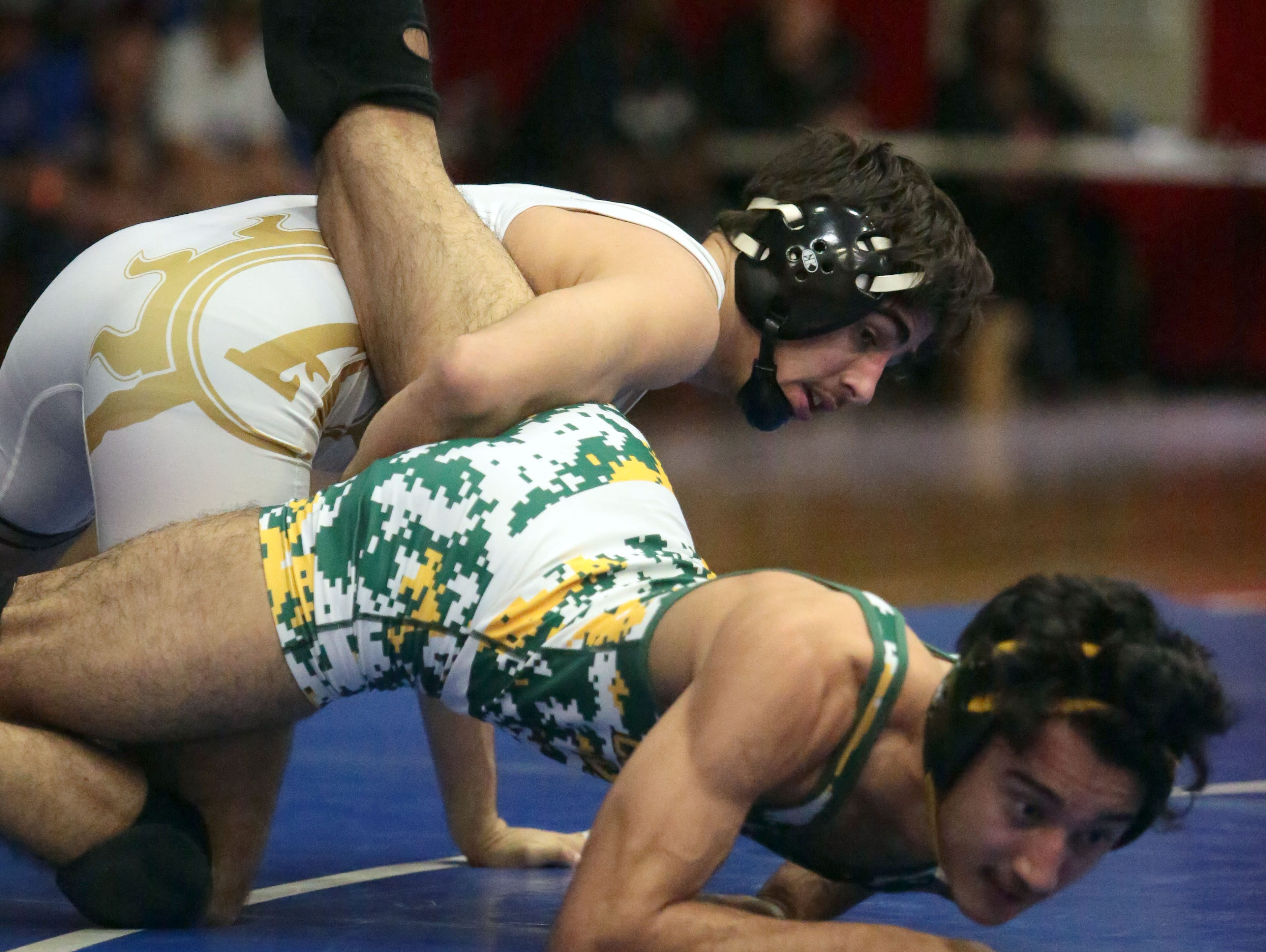 Palm Desert's Billy Weaver takes on Coachella Valley's Jose Cano for the 138 pound DVL Wrestling title on Saturday, January 30, 2016 at Palm Springs High School. Weaver won the match.