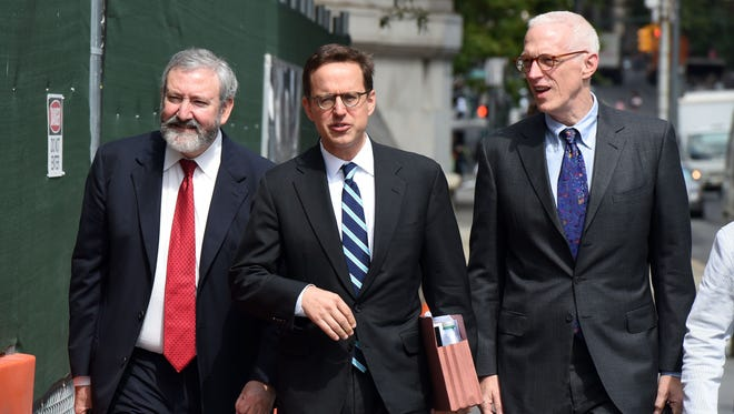 Attorney for Argentina Carmine Bocuzzi (C) arrives at U.S. District Court for a hearing June 27, 2014, in New York.