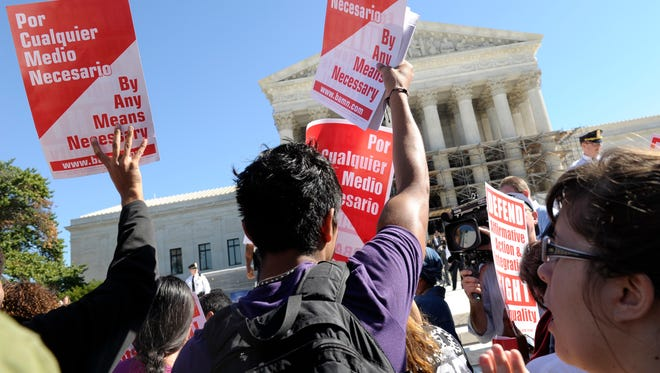 Proponents of affirmative action demonstrate outside the Supreme Court during oral arguments in October 2013.
