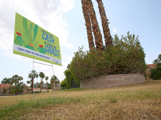 A sign at a home in Palm Springs signifies that this lawn has been replaced with desert landscaping via Desert Water Agency's turf buyback program.
