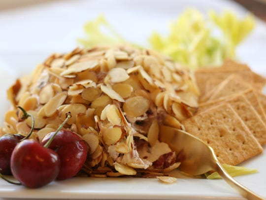 Serve Cherry Almond Cheese Ball with celery sticks and crackers.