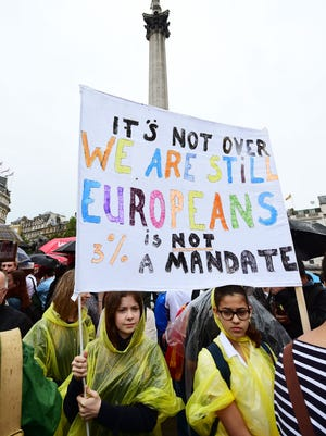 Supporters hold a banner during a pro-EU rally in Trafalgar Square in London, after some of the pro-EU events organized in the aftermath of last week's historic referendum have been cancelled at short notice over safety concerns, Tuesday, June 28, 2016. (Ian West/PA via AP) UNITED KINGDOM OUT  NO SALES NO ARCHIVE