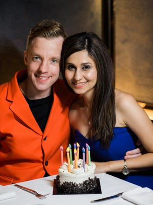 Ricky Smith, president of R. A. Smith in Brookfield met his wife, Mona Ashraf Khorasani, in Iran nine years ago. The picture is of them celebrating her birthday in Canada.