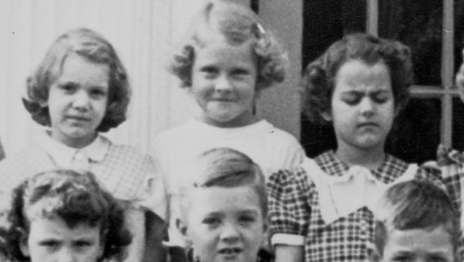 Now Governor Kay Ivey in her first grade class photo in Camden, Ala. Ivey is back row center.