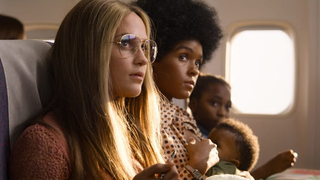 """Alicia Vikander as Gloria Steinem, left, and Janelle Monae as Dorothy Pitman Hughes in a scene from """"The Glorias."""""""