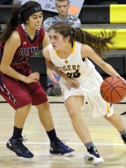Brooke Anderson dribbles around Deming's Jazlyn Garcia on Friday night.
