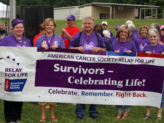 Five cancer survivors were given the honor of carrying the banner at the American Cancer Society's annual Montgomery County Relay for Life. Left to right, Shauna Garvin, Joy Roberts, Boots Streetman, Kristi Sheppard and Phyllis Streetman.