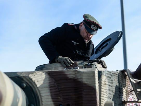 Randy Short, who portrays a German army tank crew member,