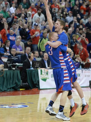 Tri-Village's Knox Morris, left, and Colton Linkous celebrate their Division IV State basketball victory over Harvest Prep, Saturday, March 28, 2015, at Ohio State in Columbus, Ohio.