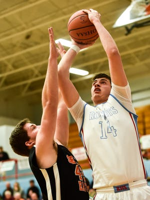 Ridgedale's Alex Eldred goes for a layup against Seneca East in a boys basketball game last year. Eldred is one of the top returnees in Marion County this season.