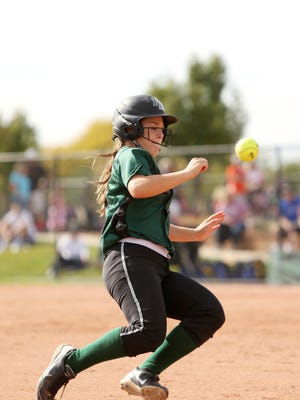 Fossil Ridge's Rheanna Will dodges the ball while running to third base in a game last year. The SaberCats open the season ranked No. 4 in Class 5A.