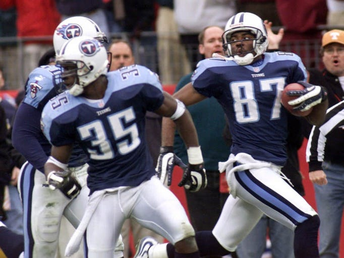 Titans receiver Kevin Dyson (87) looks back as he returns a kickoff with seconds remaining in the fourth quarter to defeat the Buffalo Bills in an AFC wild-card game on Jan. 8, 2000. The play was the brainchild of special teams coach Alan Lowry, who was fired by the Titans on Friday.