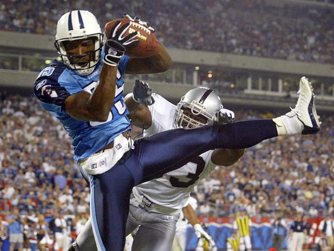 Tennessee Titan receiver Derrick Mason (85) catches a pass for a touchdown during the fourth quarter at the Coliseum Sept. 7, 2003. The Titans won the season opener 25-20.