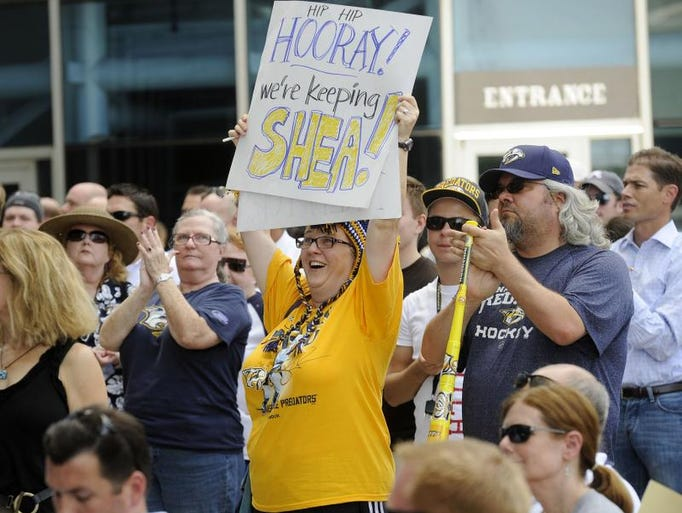 Jean Wilson holds up a sign celebrating the signing of Nashville Predators captain/defenseman Shea Weber on the plaza of Bridgestone Arena Wednesday, July 25, 2012.