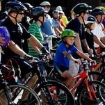 Riders line up before the Bicycle Ride for Peace on July 9, 2016. The ride, put on by the Indianapolis Ten Point Coalition, in cooperation with Indianapolis Metropolitan Police Department, started at IPS School 43 and traveled through the Butler-Tarkington, Crown-Hill, and UNWA neighborhoods. Riders participated to promote peace and encourage community residents to get involved in taking back their neighborhoods.