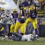 LSU running back Derrius Guice (5) carries in the second half against Eastern Michigan.