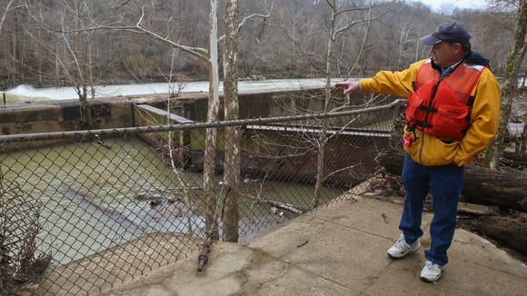 Army Corps of Engineers chief of environmental resources Mike Turner discussed possible removal of the dilapidated Green River Lock and Dam 4 in 2014, while water rushed over the dam. Trees could be seen growing from the lock chamber, which hasn't been used since 1951.