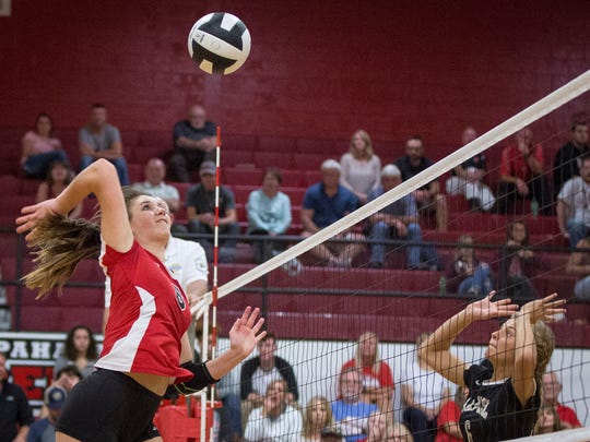 Wapahani's Estella Davis sends the attack across the net during the game against Lapel Tuesday evening during the IHSAA sectional volleyball game. Wapahani took the match 3-0.