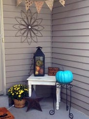 The teal pumpkin that sits on the porch of Sherry Cochrane's