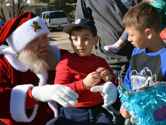 Five-year-old Nikolas Granados sits on Santa's lap