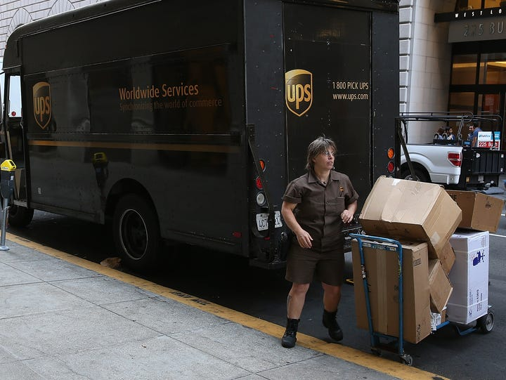 A United Parcel Service driver unloads packages from
