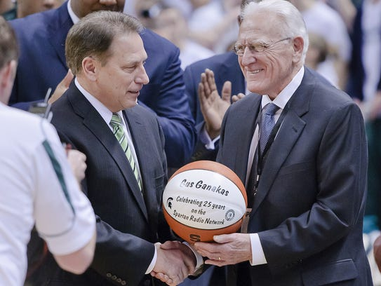 Tom Izzo (left) congratulated former MSU coach Gus Ganakas on 25 years of service on the Spartan Sports Network in 2011.