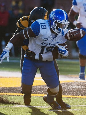 Kentucky's Stanley Williams, right, fumbles the ball as he is hit by Missouri's Charles Harris during the third quarter of the Tigers' win over the Wildcats in 2014.