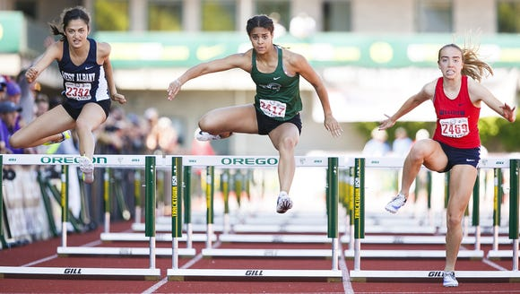 West Salem's Keira McCarrell clears the last hurdle