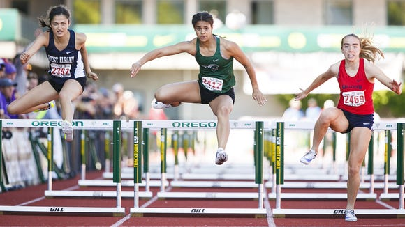 West Salem's Keira McCarrell clears the last hurdle in the 6A 100 hurdles at the 2017 OSAA track and field state championships on Saturday, May 20, 2017, at Hayward Field in Eugene, Ore.