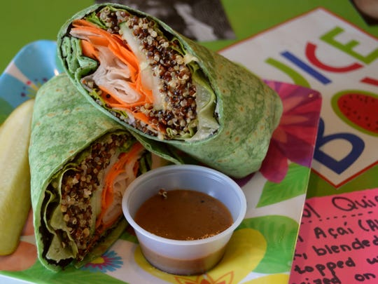 The Asian wrap from Juicebox, prepared with wasabi aoli, nori, greens, qunioa, Asian dressing, cucumber, carrot and daikon in a spinach wrap.