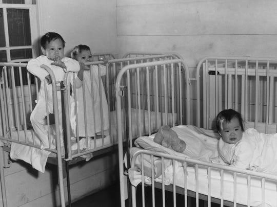 "Children in a nursery at the Manzanar Relocation Center in 1943. The internment camp's ""Children's Village"" was home to about 100 Japanese-American orphans who were relocated from West Coast foster homes and institutions during World War II."