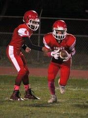 Cobre quarterback Danny Ortiz hands off the football