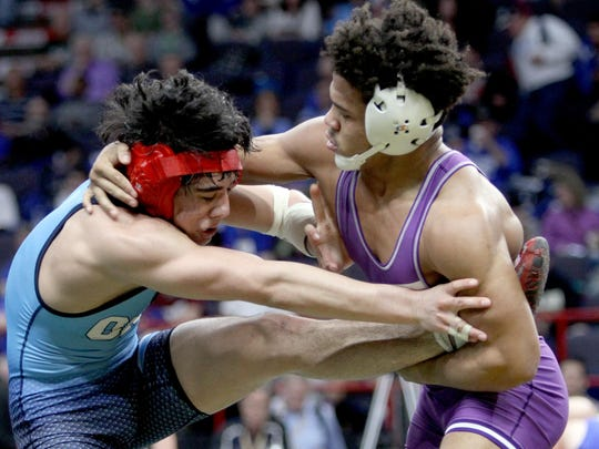 Frankie Gissendanner of Penfield, right, defeated Mike Criscione of North Rockland in a 145 pound bout during the quarterfinals of the NYSPHSAA Wrestling Championships at the Times-Union Arena in Albany Feb. 24, 2017.