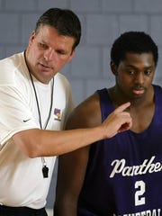 Former UNI basketball coach Greg McDermott instructs Eric Coleman during practice.