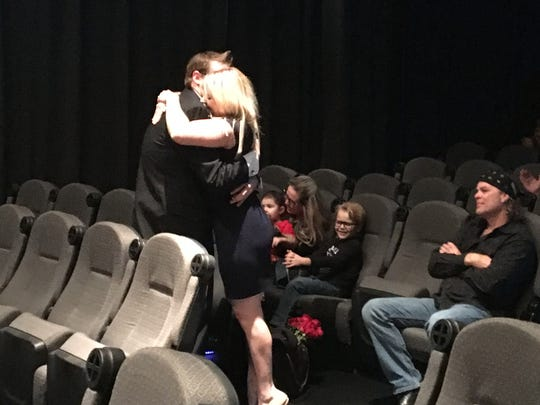 Tom Edwards (right) watches as his daughter, Chelsea, hugs her boyfriend following a wedding proposal that took place Sunday at Westfield Palm Desert.
