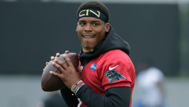 Carolina Panthers coach Ron Rivera says quarterback Cam Newton is ahead of schedule in his rehab from shoulder surgery and is expected to begin throwing at minicamp.