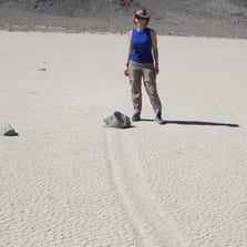 A Death Valley visitor patiently waits at the Racetrack Playa for a rock to move.