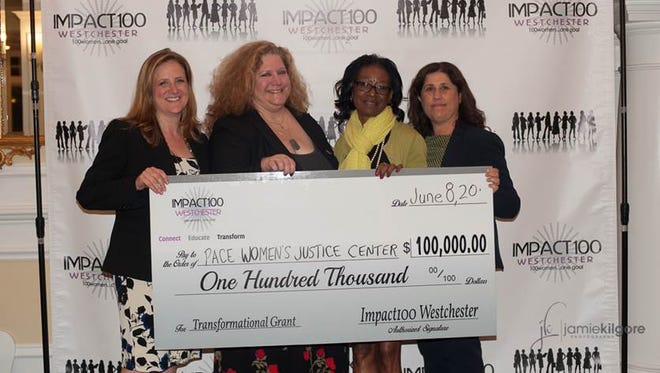 One June 8, 2016, the Pace Women's Justice Center in White Plains received a $100,000 grant to create a walk-in legal resource center. Pictured, from left, are PWJC Associate Director Jana Kosberg-Kleidman, PWJC Pro Bono Programs Director Natalie Sobchak, former PWJC client Toni Everett, and PWJC Executive Director Cindy Kanusher.