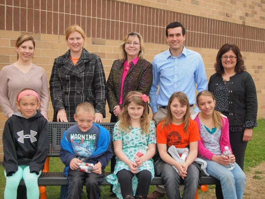 Members of Kickstarters, with the Buddy Bench at the Friendship Learning Center in North Fond du Lac. Front row, from left are: are Ella Morenzien, Noah Metcalf, Nadia Kounelis, Natalie Wolfe and Gabby Ojeda. Back row: Carrie Lauersdorf, Kondex Corporation; Amber Kilawee, Fond du Lac Area United Way; Karen Befus, Action Reporter Media; Luke Wacek, Johnsonville Sausage; Kim Spartz, Moraine Park Technical College