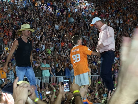 Peyton Manning joined Kenny Chesney onstage at the artist's concert at Bristol Motor Speedway.