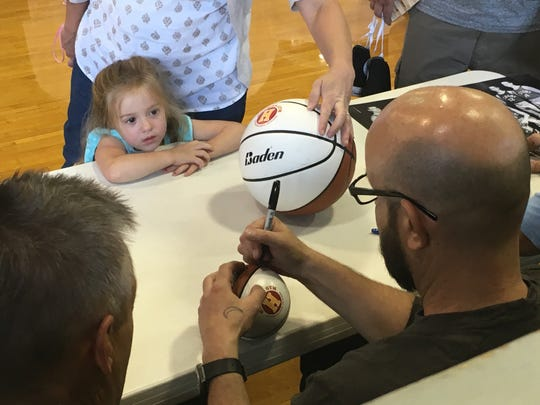 "Retired actor David Neidorf signs an autograph for a fan at the ""Hoosiers"" 30th anniversary event at the Hoosier Gym in Knightstown."