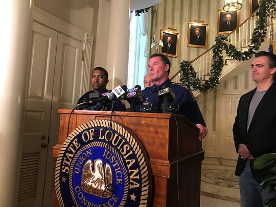 State Police Col. Rick Edmonson, joined in Wednesday's press conference by TASER CEO Rick Smith, right, announced all trooper will be equipped with body cameras.