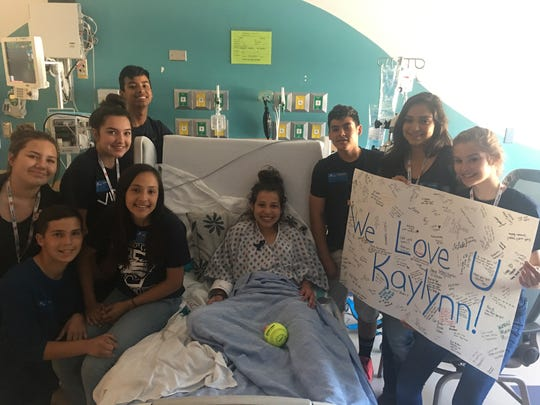 Friends and family show support for Kaylynn Cuaron, a 14-year-old Vista Middle School student who collapsed while competing in a district track meet on Friday, April 28, 2017.
