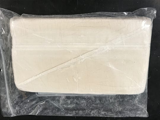 Pictured is approximately 1,000 grams of fentanyl from a drug bust. The drug was being tested at the Hamilton County Crime Lab on May 16. Along with the fentanyl, the bust also included 500 grams of a mixture of acrylfentanyl and fentanyl. Workers in the crime lab have increased safety and security due to the deadly substances. The crime lab is part of the coroner's office under the direction of Dr. Lakshmi Sammarco.