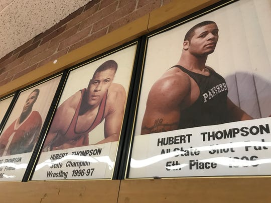 "Hubert ""Boo Boo"" Thompson's photos line the wall of the hallways at Proviso West High School in Hillside, Illinois. Thompson was a state champion wrestler for the Panthers and was one of the top football recruits in the country in 1996."